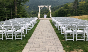 Empty Ceremony with White Chairs and Prepared Sand Ceremony Table