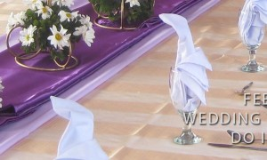 Wedding Reception Table with Striped Beige Table Cloth and Purple Runner