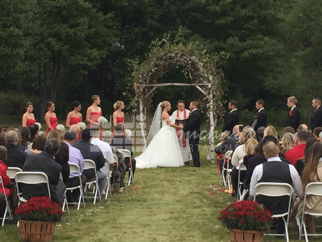 Bride and Groom Saying Their Vows at the Arbor