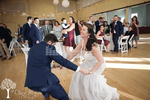 Bride and Groom Enjoying Their First Dance While Laughing