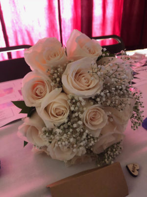 A Bouquet of White Roses at a Wedding Reception