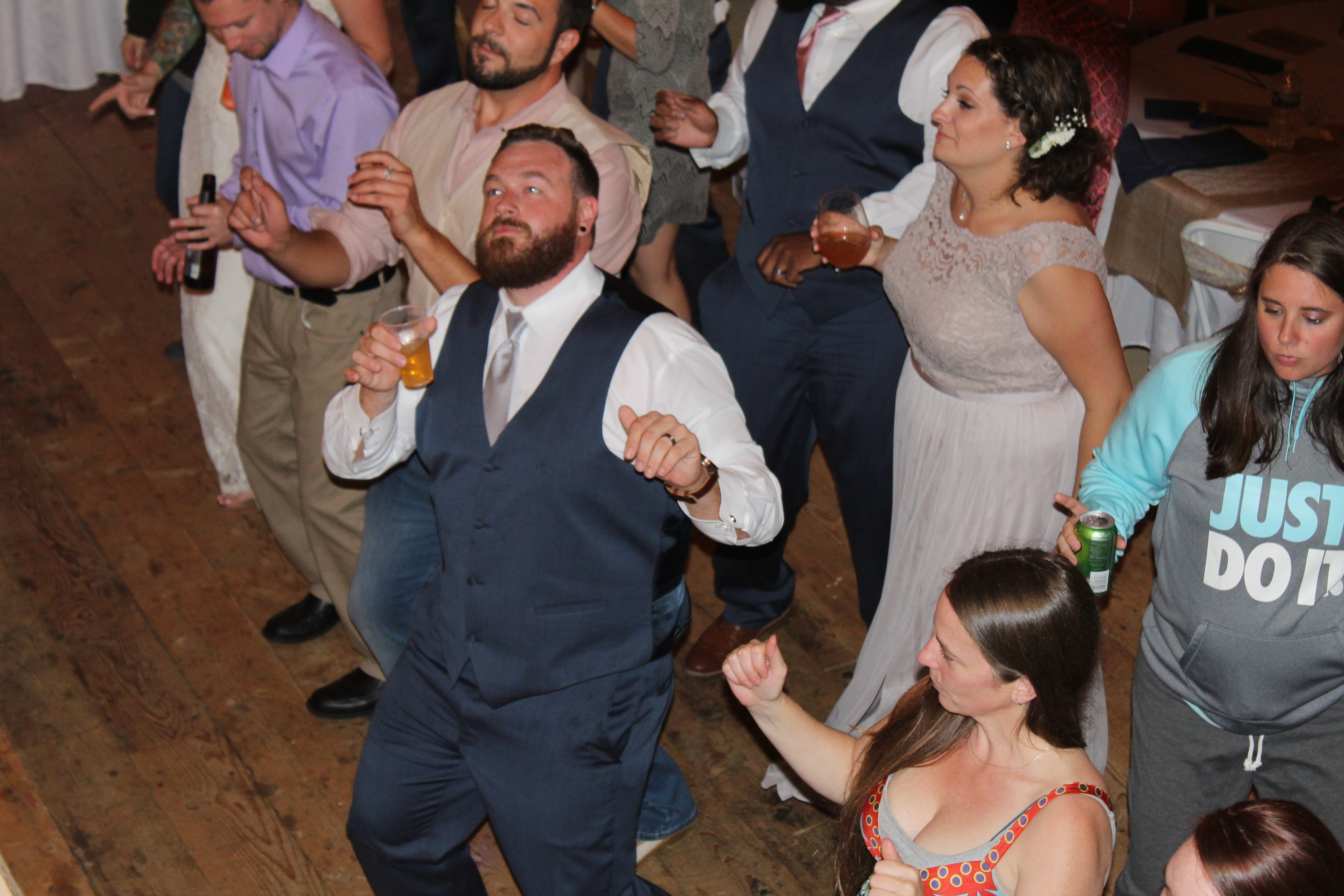 Groom and Guests doing the Wobble by V.I.C