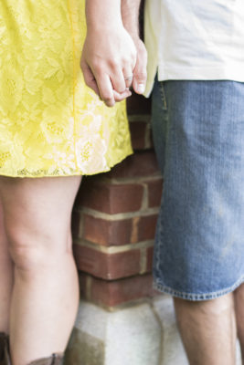 Couple Holding Hands from Waist Down After She Said Yes To Getting Engaged