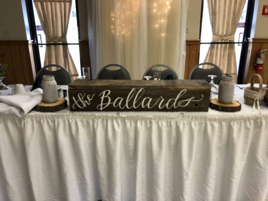 "Wedding head table with a handmade rustic box with the couples last name on it. ""The Ballards"""