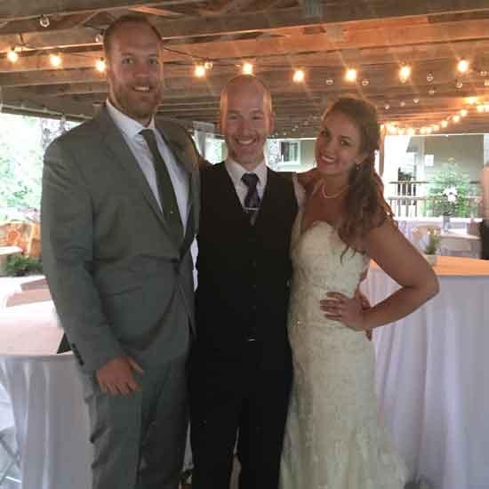 maine dj chris bouchard with bride and groom