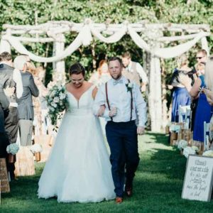 Bridge and Groom recessing from their ceremony at The Five Bridge inn Rehoboth MA