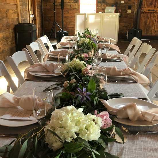 kings hill and barn wedding decor and dj set up