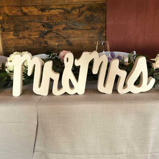 mr and mrs sign at kings hill inn and barn in maine